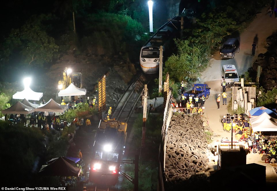 The wreckage is pictured at the scene where a train carrying 490 passengers has been derailed in a tunnel