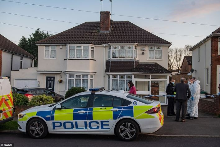 Police at the scene in Rowely Regis, West Midlands, on April 2 2021.Police said the woman 'sustained dog bite injuries', but noted that a post mortem examination would take place soon to establish the cause of death