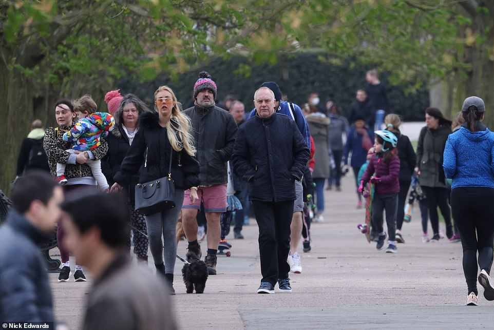Crowds of people were out and about in London's Greenwich Park this morning to take advantage of the mild weather