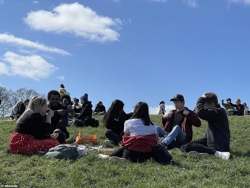 People gather on the grass in Primrose Hill, overlooking the rest of the capital, at the start of the Easter weekend