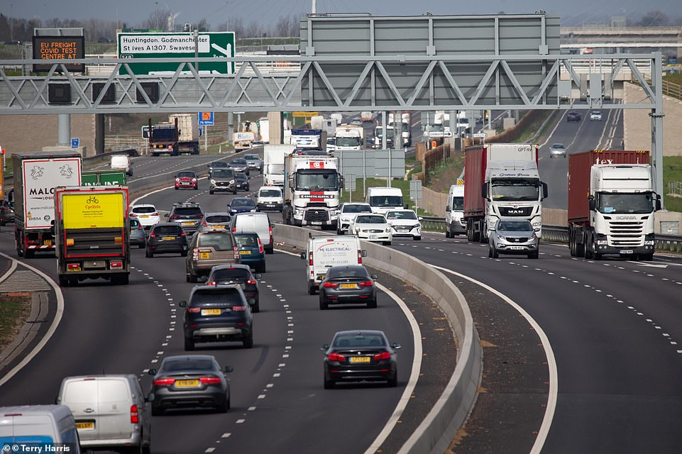 A survey by the RAC projects 5.6million cars will hit the road this weekend to visit loved ones, taking advantage of the four-day holiday and end of the 'stay at home' orders, which were replaced with 'stay local'. Pictured, A14 traffic yesterday