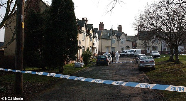 The house where Ms McKitten's body was found in 2008 is pictured behind a police cordon