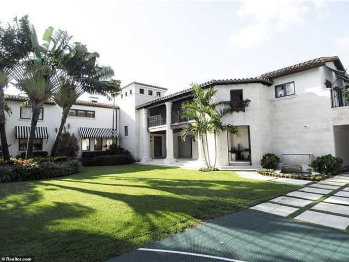 The Mediterranean-style home was built in 1936 and sits on a 17,500-square-foot lot with a pool and dock