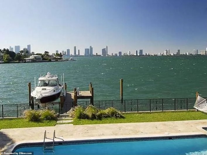 The two-story, six-bedroom and five-bathroom house has 100 feet of water frontage with room for am90-foot yacht