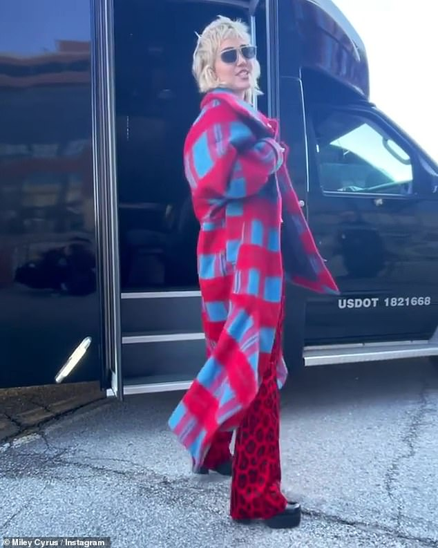 Chic: The 5ft5in beauty stayed warm against the Midwestern temperatures with a red-and-blue coat and scarlet leopard-print bellbottoms with black platform shoes