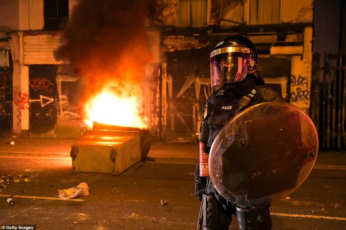 Eight police officers have been injured after they came under attack from youths throwing bottles, bricks and fireworks during a riot in a loyalist area of Belfast