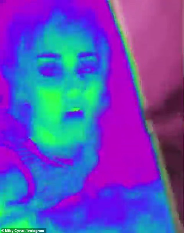 Trippy:She looked as if she was in the midst of a psychedelic trip in a funny candy-colored clip of herself rocking out while on board her plane that she posted around the same time