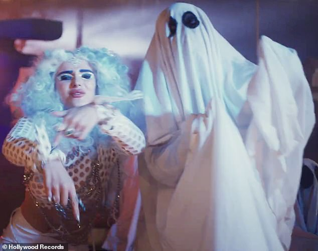 Goofing around: The video had a surreal vibe as she repeated that she was 'a ghost, call me Phantom' while surrounded by backup dancers who were covered in sheets with eye-holes