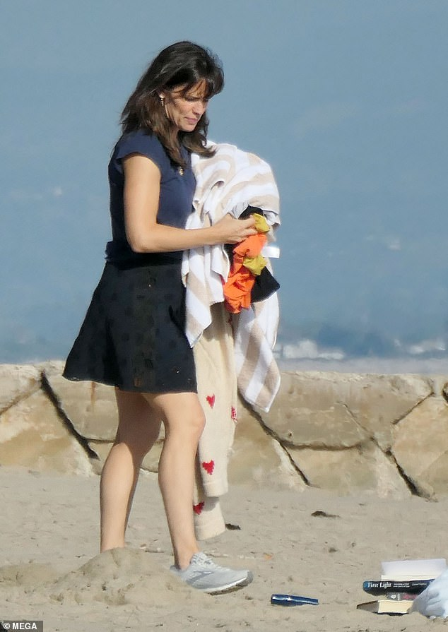 Work, work, work! Jennifer Garner was back to work as she was seen clearing up after taking part in a photoshoot on the beach on Friday in Santa Barbara