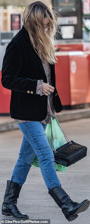 Accessorising tastefully:Her windswept tresses were left in a natural straight style as she was seen clutching a classic quilted handbag
