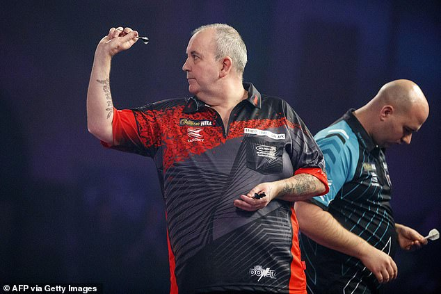 'The Power' (L) stepped away from the sport professionally after his 7-2 defeat by Rob Cross (R)