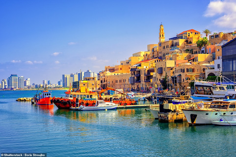 Pictured:Old town and port of Jaffa and modern skyline of Tel Aviv city, Israel, which could be a destination for holidaymakers