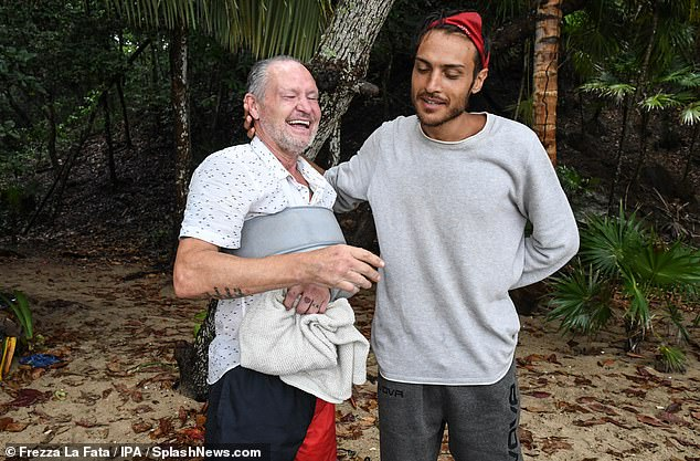 Missed:Youtuber Simone Paciello sympathetically rested his hand on a joyful Paul's neck as they caught up following his grand return