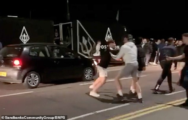 The partying students scrap in the middle of the street outside Tesco in Sanbanks, Dorset