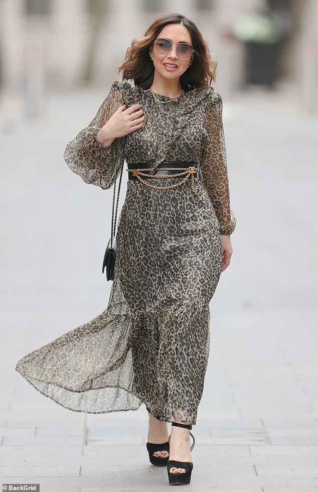 Work it!Myleene Klass looked sensational once again in a sheer animal print dress as she arrived at work to present her Smooth Radio show on Saturday