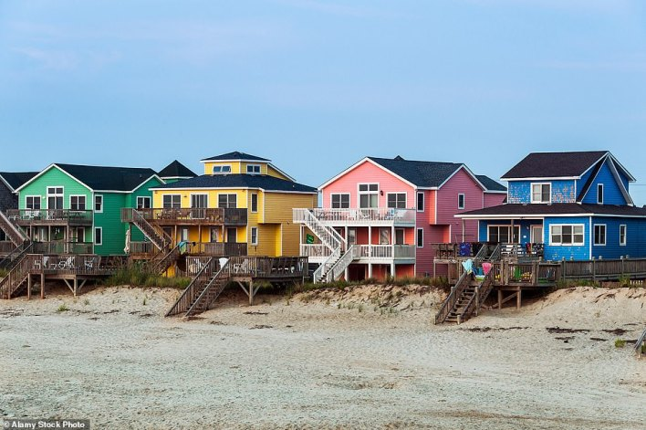 The high life: The colourful beach houses on North Carolina's Outer Banks.City-dwelling 'Southerners' head to the Outer Banks' six towns and 12 coastal villages for sun, sea, sand and the occasional kitesurf between the months of April and August