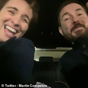 Having fun: The duo could barely contain their laughter as they moved their heads in and out of the camera frame and waved their arms around