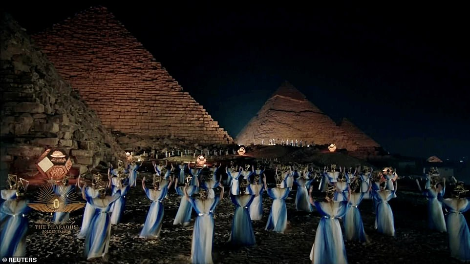 Artists perform near pyramids in a video screened during the ceremony. Movie star Hussein Fahmy said in an official promotional video: 'Again, Egypt dazzles the world with an unrivalled event'