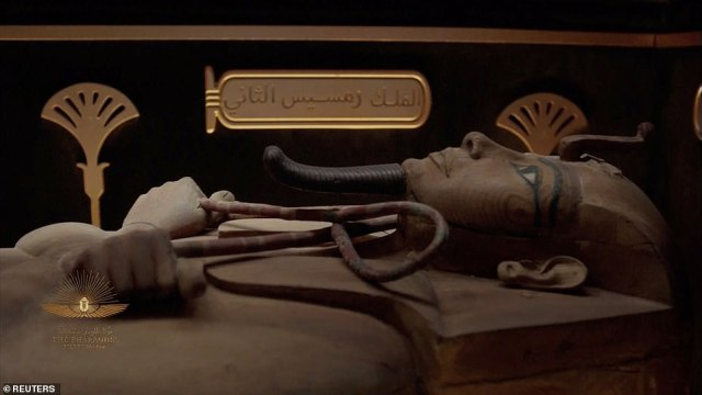 A mummy is seen in a video screened during the ceremony. They were originally buried around 3,000 years ago in secret tombs in the Valley of Kings and the nearby Deir el-Bahri site
