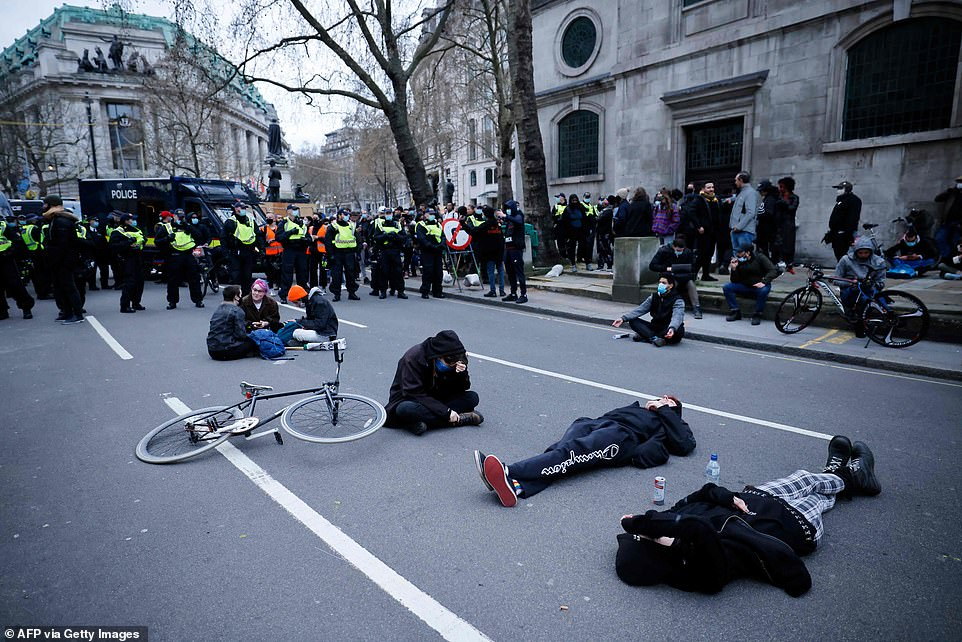 Police officers surround demonstrators lying on the road as they take part in the protest. The Police, Crime, Sentencing and Courts Bill would give police in England and Wales more power to impose conditions on peaceful protests