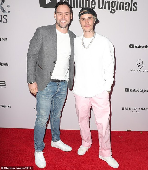 What a couple: The customers and employees in question are those who have been involved with Scooter Braun Projects since its launch in 2007;  Scooter and Justin get photographed last January.