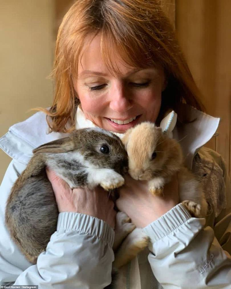 Hare for the weekend: Geri Horner marked the Easter weekend by sharing snapshots of herself doting on two bunny rabbits, alongside the pun-filled caption, 'Somebunny loves you'