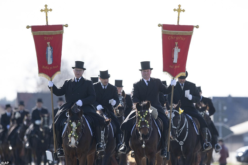 The traditionally dressed Sorbian Easter riders proclaim the Easter message on horseback according to an old custom in Ralbitz, Germany