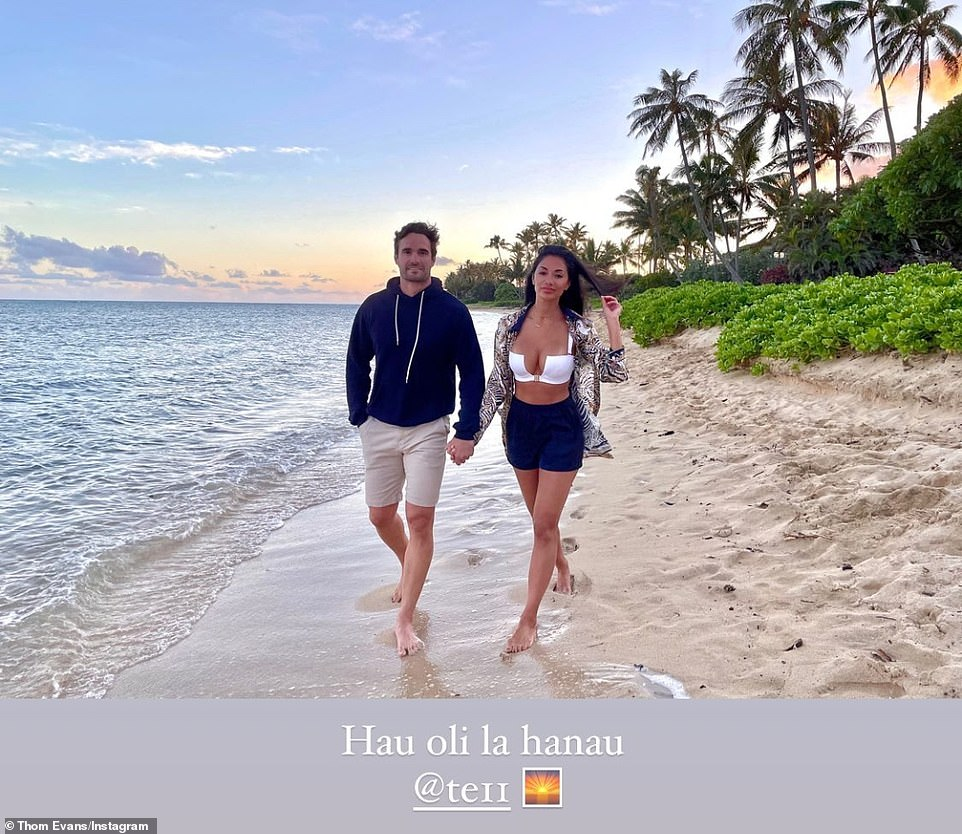 So romantic: They were also seen strolling the golden shores and-in-and as the crystal clear ocean water lapped at their feet