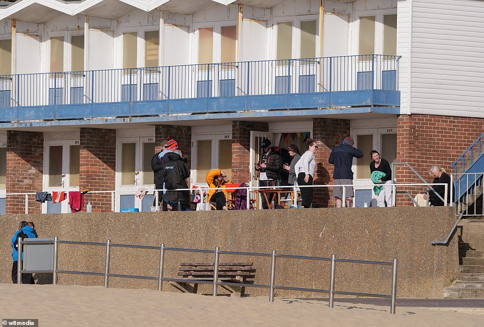 Family's gather in beach front huts on Sandbanks, as the weather and covid restrictions finally allow the meetings
