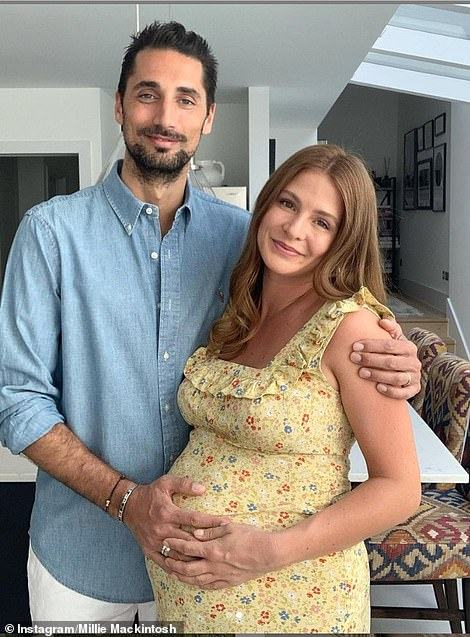 Bump: Throwing it back one year, Millie's bump was cradled by Hugo as they counted down to the birth of their daughter - who arrived on May 1, 2020