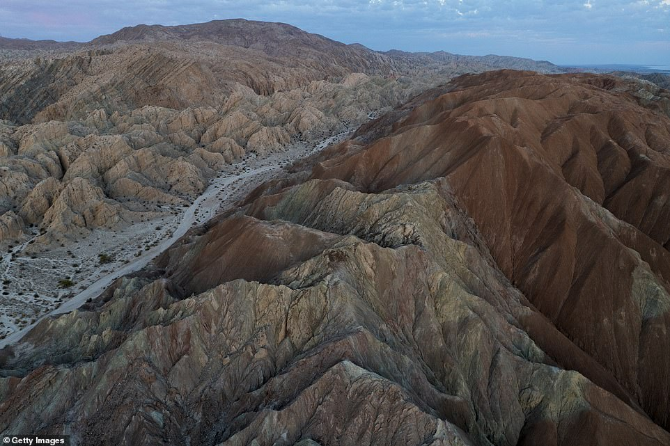 The San Andreas fault runs much of the length of California and marks the boundary between the Pacific and North American continental plates. Where the plates collide mountains form as the land crumples like a sheet of paper (pictured is a section near Mecca in southern California)