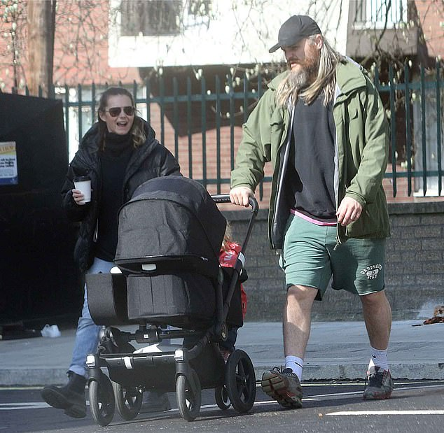 Family stroll: Kara Tointon and her fiancé Marius Jensen were spotted taking her sons Frey, two, and newborn Helly for a stroll in London on Easter Sunday