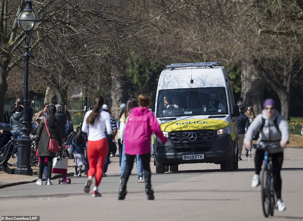 Police patrol as members of the public gather in Hyde Park. On April 12th England is set to relax more lockdown restrictions, which were imposed to control the spread of COVID-19