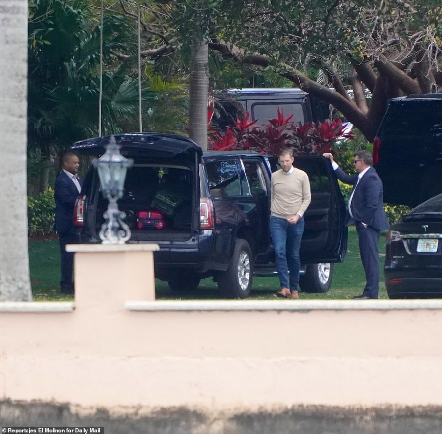 Eric is seen packing multiple suitcases into a vehicle parked at Mar-a-Lago on Easter Sunday