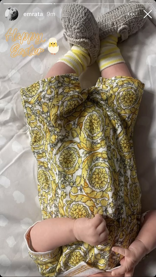 Oh baby! The newborn was all dressed up for Easter in a yellow onesie and grey booties