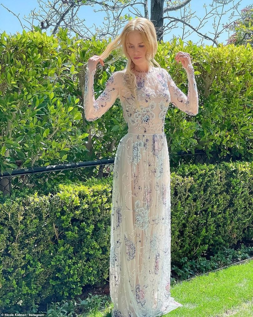 Spring queen:Kerry Washington jumps into her pool in her SAG Awards gown Nicole Kidman dazzled in a spring ready gown that featured embroidered floral detailing all over; the long-sleeved gown featured sheer fabric over a nude undergarment, with a defined waistline