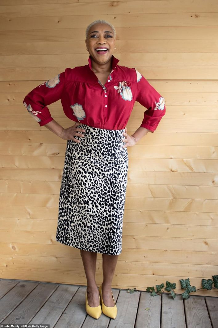 Stylish: Karen Robinson donned  a leopard printed skirt with  a patterned top, adding yellow heels
