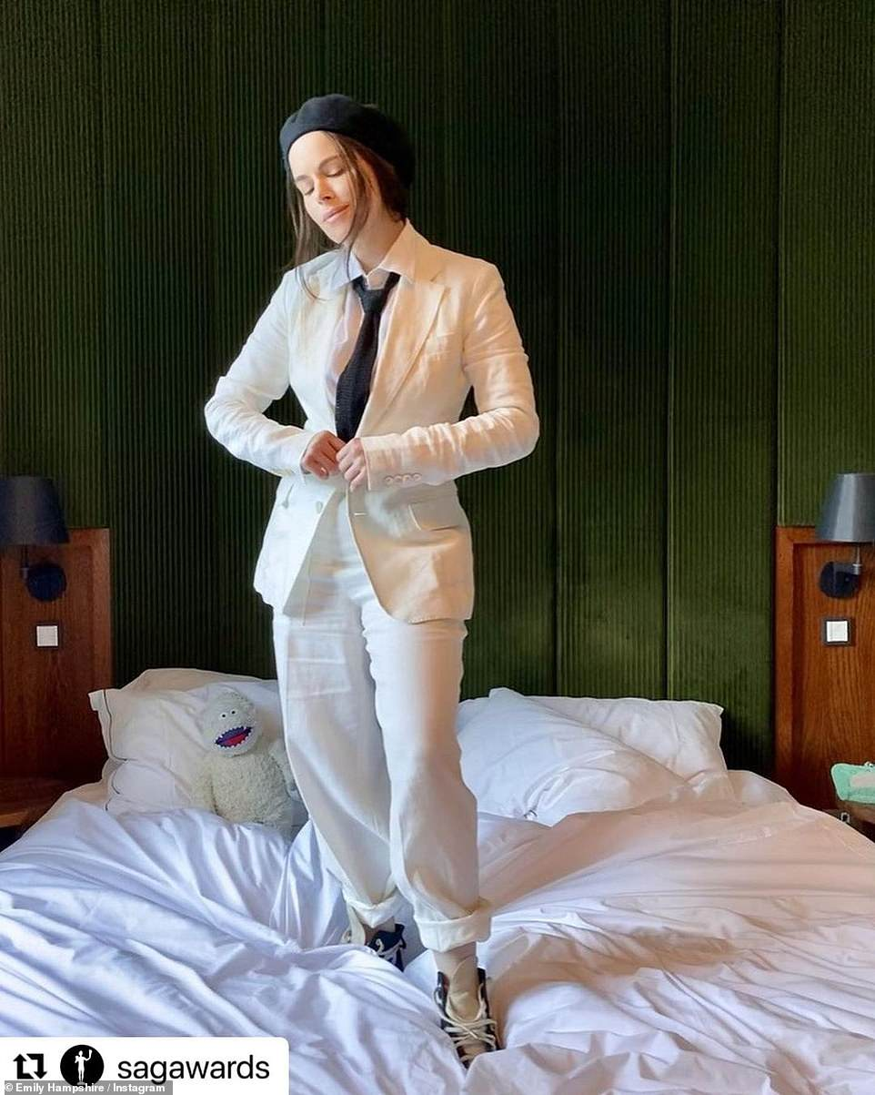 Missing the mark: Schitt's Creek star Emily Hampshire opted for a cream linen suit with black tie and sneakers