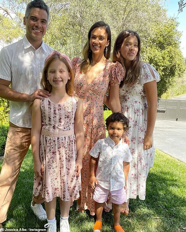 Happy fam: She posed alongside her film producer husband Cash Warren and their three children, daughters Honor Marie, 12, and Haven Garner, nine, and three-year-old son Hayes