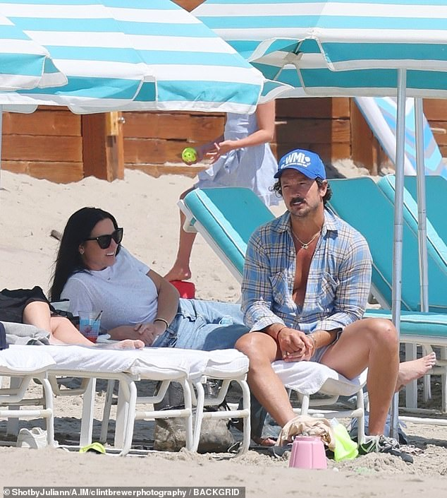Holiday in the sun: Disgraced Hillsong NYC paster Carl Lentz and his wife Laura Lentz soaked up the sun on Easter Sunday on a beach in Santa Monica