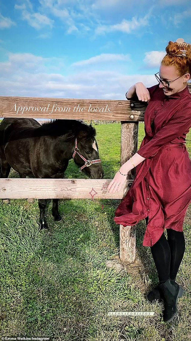 One image showed Emma posing alongside a pony, showing the animal her ring, which he captioned: 'Approval from the locals'