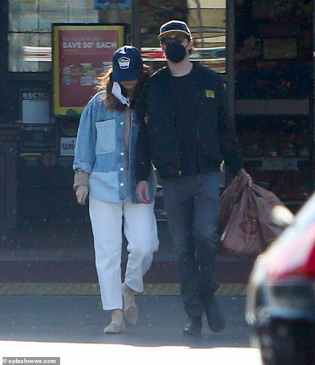 Accessories:The Mamma Mia star donned a navy baseball cap and brown flats, while a white face mask dangled from one ear as she left the store