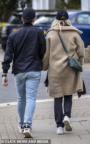 Stepping out: The couple enjoyed a scenic stroll to their local park on Friday