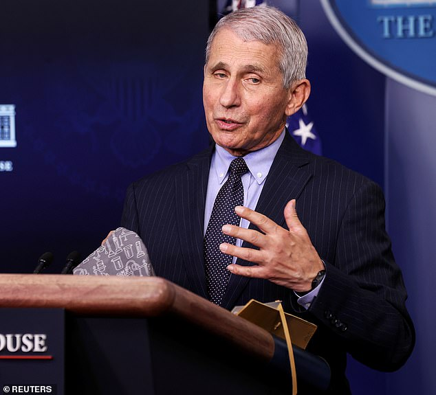 Dr Anthony Fauci said during an appearance on the POLITICO Dispatch podcast on Monday morning that the U.S. government will not require the use of vaccine passports. Pictured: Fauci during a press conference at the White House, January 2021