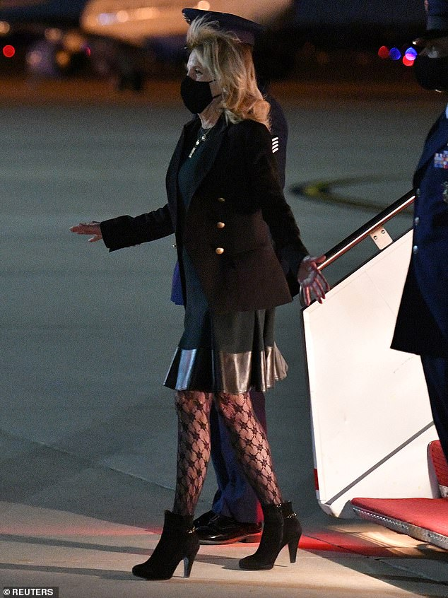 Under fire: Jill Biden's patterned tights sparked outrage among critics on social media, with some branding the 69-year-old's ensemble 'trashy' and 'embarrassing'
