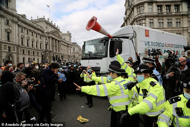 Pictured: Police intervene as protestors attempt to stop a delivery truck during the 'Kill the Bill' protest held in opposition to the Government's Police, Crime, Sentencing and Courts Bill