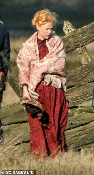 Outfit: The actress, 41, transformed into a Victorian beauty as she donned a flowing red dress while shooting on location for the AppleTV+ series