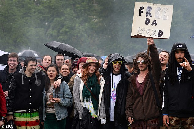 Protesters smoke cannabis during a demonstration calling for cannabis to be legalised at a 420 Day event in Hyde Park in London, on April 20, 2014
