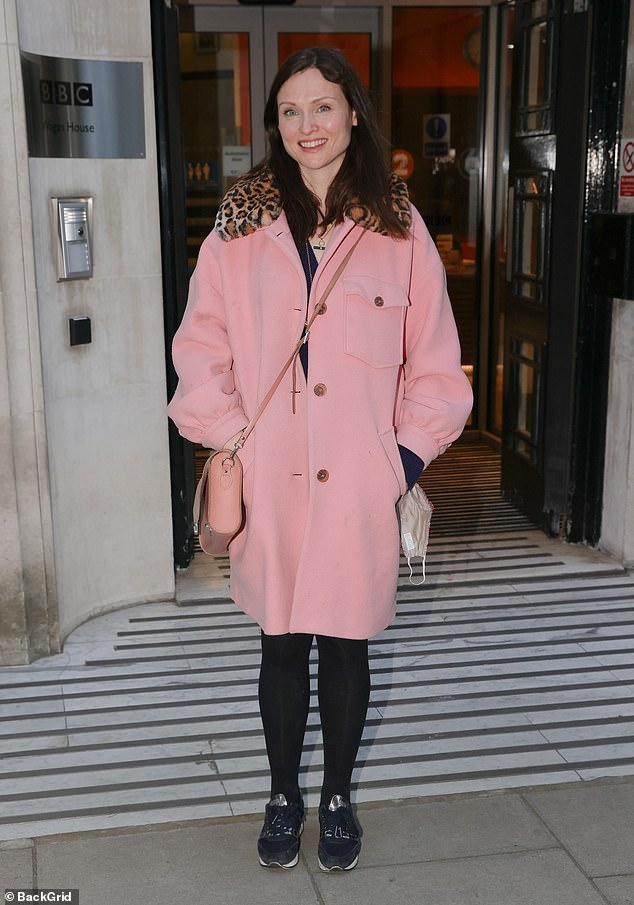 Pretty in pink: Sophie Ellis-Bextor covered up in a chic pink coat with a faux-fur leopard print collar as she left the studio after her BBC Radio 2 appearance on Monday