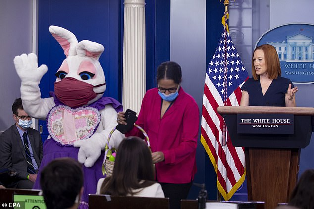 White House Press Secretary Jen Psaki looks on as the Easter Bunny arrives at her press briefing to pass out chocolates and commemorative eggs
